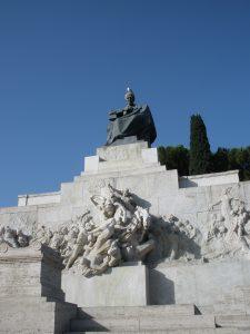 A statue of Giuseppe Mazzini seated above the Circus Maximus